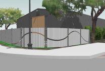 dom otoczony panelami ogrodzeniowymi